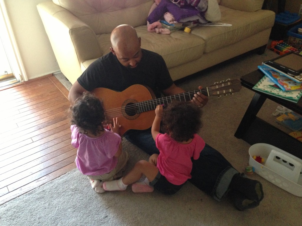 Playing guitar with Dad...