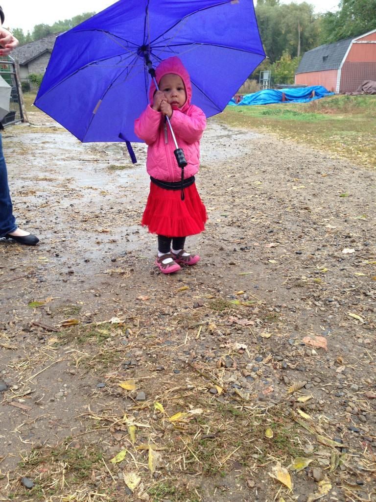 Vanessa, bundled up and taking a rainy Sunday stroll...